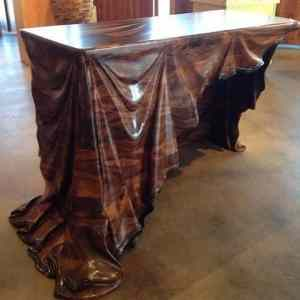 Wooden table with wooden cloth carving